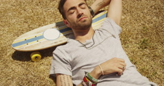 Hispanic sleeping napping outdoors Stock Footage