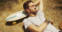 Attractive hispanic sleeping napping outdoors Stock Footage