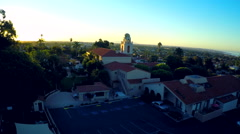 An aerial shot over a California mission tower at sunrise. - stock footage