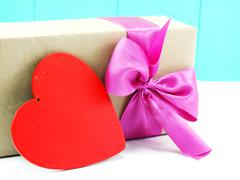 red heart and gift box with pink bow - stock photo