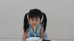small pretty girl with stainless fork in hands eats noodles, close-up - stock footage