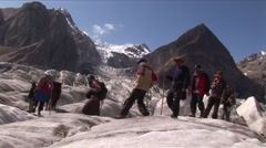 Tourists crossing Glacier Stock Footage