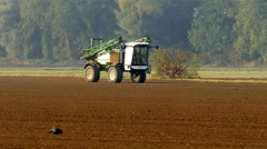 Crop sprayer with folded booms. - stock footage
