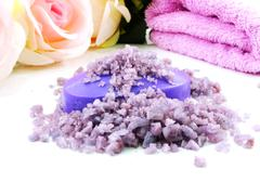 Stock Photo of sea salt spa and soap lavender scent on white background selective focus