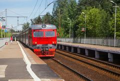 The electric train arrives at the platform Vodniki in Moscow Stock Photos