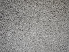Uneven surface of the gray cement - stock photo