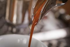 coffee extraction from professional coffee machine - stock photo