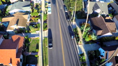 Beautiful rising aerial shot over a palm tree lined street in Southern Stock Footage