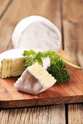 Soft white rind cheese on a cutting board Stock Photos