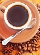 Fresh aroma coffee in the cup, coffee and cinnamon - stock photo