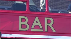 Red Bus Bar zoomout. - stock footage