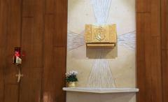 Golden Tabernacle and lighted candle - stock photo