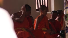 Buddhist Monks praying in Monastery Stock Footage