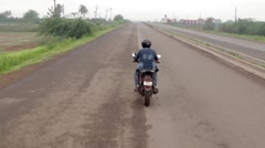 Motorbike ride on Indian Road Stock Footage