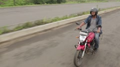 Man on motor cycle in India - stock footage