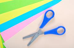 Scissors and color paper Stock Photos