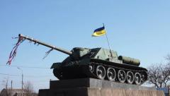 Tank on the pedestal with a Ukrainian flag - stock footage