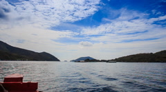 boundless azure sea islands on horizon from boat against sky - stock footage