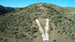 Aerial shot over the historic V on a hillside in Ventura, California. Stock Footage