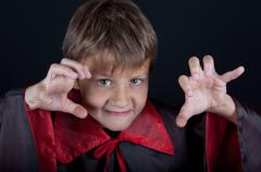 Boy dressed like vampire for Halloween party Stock Photos