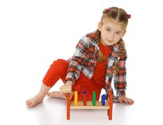 little girl in a Montessori environment - stock photo