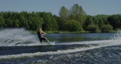 Stock Video Footage of Extreme Sport Wake Board Tricks and big air behind boat