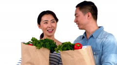 Stock Video Footage of Asian smiling couple holding food bags