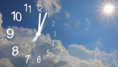 Clock with rolling cumulus clouds, time lapse. Sun shines among the clouds Stock Footage