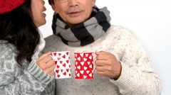 Couple both having warm drinks Stock Footage