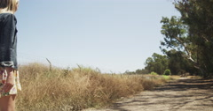Young hipster woman walking on a dirt trail Stock Footage