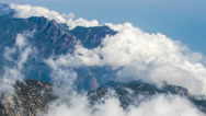 Stock Video Footage of Mountain Ridge and Clouds Timelapse