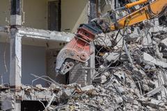 Demolition crane dismantling a building Stock Photos
