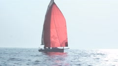 Red yacht sailing in the Arabian Sea Stock Footage