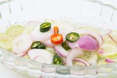 Islamic dish made of cucumber slices and onions in vinegar - stock photo