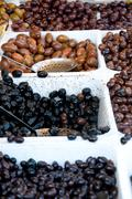 Container containing olives of various colors Stock Photos