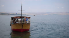 Wooden boat on the sea of Galilee Stock Footage