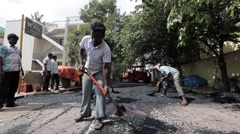 Workers constructing roads in Mumbai 3 Stock Footage