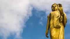 Big Gold Buddha against Blue Sky. Timelapse Stock Footage