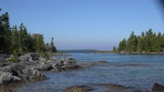 Small Cove in Georgian Bay with passing boat Stock Footage