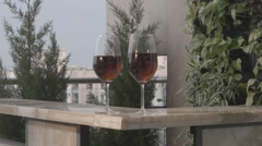 Red Wine Glasses in Balcony Stock Footage