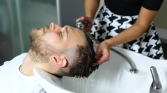 young man at the hairdresser - stock footage