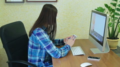 Girl in office with computer Stock Footage