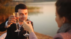 Tenderness couple with wine on sunset beach - stock footage
