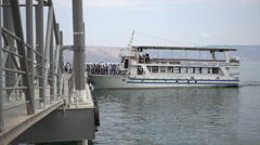 Tourist go off boat after cruise on the sea of Galilee Stock Footage