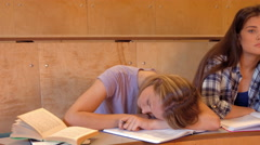 Student asleep with partner on the verge Stock Footage