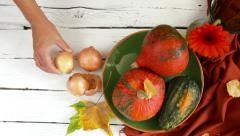 Food stylist works with Autumn table composition - stock footage