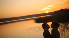 Silhouette of dancing couple - stock footage