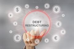 business hand pushing debt restructuring button - stock photo