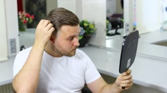 The young man at the hairdresser salon hairstyle make model Stock Footage