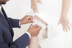 Wedding tradition wearing a Garter Stock Photos